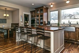 Craftsman Kitchen with Pendant light, Complex granite counters, flush light, Glass panel, Limestone Tile, Breakfast bar