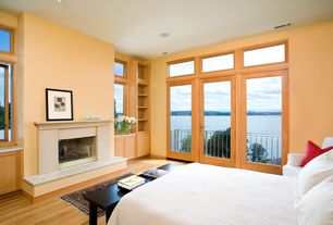 Contemporary Master Bedroom with picture window, Casement, can lights, Hardwood floors, Fireplace, Cement fireplace