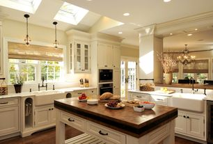 Traditional Kitchen with full backsplash, Flat panel cabinets, Wine refrigerator, Casement, Kitchen island, French doors
