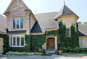 Traditional Exterior of Home with picture window, Pathway, exterior tile floors, six panel door