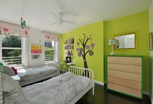 Contemporary Kids Bedroom with Laminate floors, Ceiling fan, Built-in bookshelf, Mural