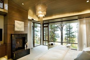 Contemporary Master Bedroom with Cathedral ceiling, Concrete floors, Chandelier, French doors