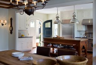 Traditional Kitchen with Simple marble counters, Restoration hardware harmon pendant, Chandelier, specialty door, Wall sconce