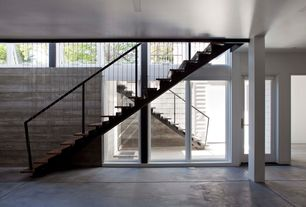 Contemporary Staircase with Columns, Concrete floors, French doors