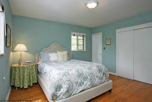 Traditional Master Bedroom with flat door, flush light, Hardwood floors, Casement, Standard height