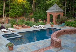 Traditional Swimming Pool with exterior stone floors, Gazebo, Pathway, Pool with hot tub, Fence