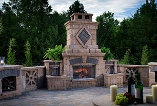 Traditional Patio with outdoor pizza oven, exterior stone floors, Fence