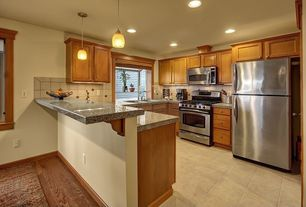 Craftsman Kitchen with U-shaped, Flat panel cabinets, stone tile floors, Limestone Tile, drop-in sink, can lights, gas range