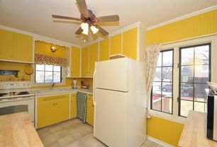 Cottage Kitchen with European Cabinets, Inset cabinets, partial backsplash, Kitchen island, Wood counters, Crown molding