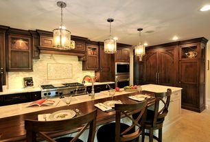 Traditional Kitchen with limestone tile floors, Inset cabinets, Wood counters, Glass panel, Flat panel cabinets, Custom hood