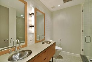 Contemporary Master Bathroom with Flush, frameless showerdoor, can lights, Wall sconce, Shower, Standard height, Double sink