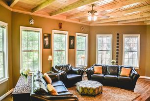 Traditional Living Room with Crown molding, Exposed beam, Hardwood floors, Ceiling fan