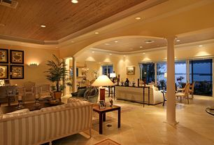 Traditional Living Room with Wall sconce, travertine floors, Crown molding, Columns