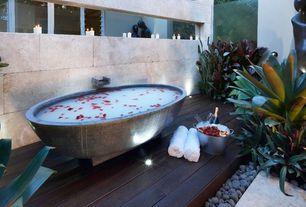 Tropical Master Bathroom with Hardwood floors, Bathtub, Square rain shower head, Standard height, Wall Tiles, Shower