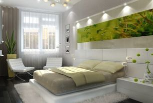 Modern Master Bedroom with Laminate floors, Pendant light, Built-in bookshelf