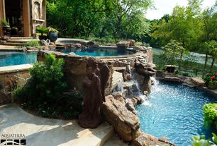 Rustic Hot Tub with Fountain, Fence, exterior stone floors