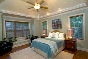 Contemporary Master Bedroom with Window seat, Ceiling fan, Hardwood floors, Crown molding, High ceiling