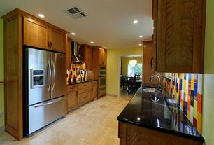 Modern Kitchen with Standard height, Flush, stone tile floors, Built In Refrigerator, Flat panel cabinets, double wall oven