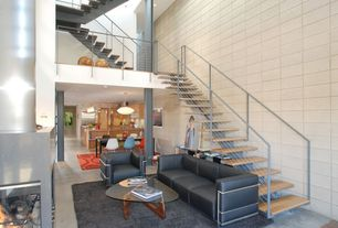 Contemporary Staircase with High ceiling, Hardwood floors, Columns, Floating staircase