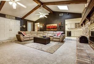 Rustic Living Room with flush light, stone fireplace, Carpet, Exposed beam, Built-in bookshelf, Ceiling fan