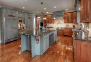 Traditional Kitchen with Simple granite counters, U-shaped, Stone Tile, Pendant light, Flat panel cabinets, Kitchen island
