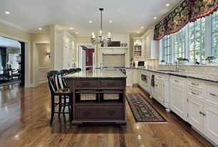 Traditional Kitchen with Undermount sink, Limestone Tile, Chandelier, Stone Tile, Flat panel cabinets, Kitchen island