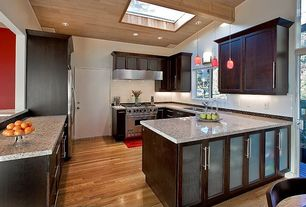 Contemporary Kitchen with French doors, Skylight, full backsplash, Standard height, flat door, Wall sconce, Glass panel