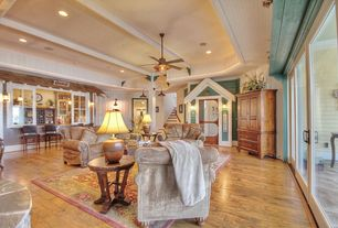 Country Living Room with Wall sconce, Ceiling fan, Hardwood floors, High ceiling, Columns, Crown molding, Exposed beam