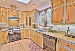 Country Kitchen with U-shaped, Inset cabinets, Ms international amarelo ornamental granite, Flat panel cabinets, Stone Tile