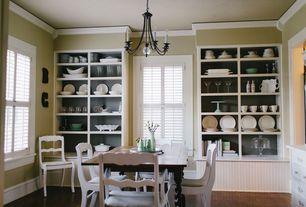 Cottage Dining Room with Hardwood floors, Chandelier, Built-in bookshelf, Crown molding