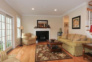 Traditional Living Room with French doors, Crown molding, Cement fireplace, Hardwood floors