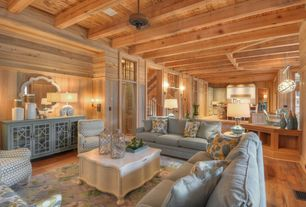 Rustic Living Room with Bayberry Media Credenza, Exposed beam, Transom window, Ceiling fan, Standard height, Wall sconce