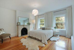 Contemporary Master Bedroom with West elm adjustable metal floor lamp, double-hung window, Ikea ps maskros pendant lamp