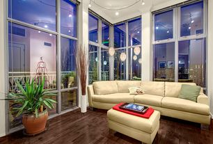 Contemporary Living Room with Hardwood floors, flush light