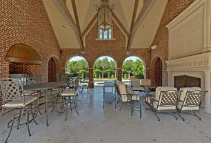 Traditional Patio with Outdoor kitchen, Pathway, exterior stone floors, Stained glass window, Fence