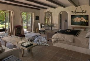 Eclectic Master Bedroom with Rustic porcelain floor and wall tile, stone tile floors, Exposed beam, Standard height