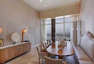 Contemporary Dining Room with Standard height, Columns, can lights, Built-in bookshelf, complex granite floors, Wall sconce