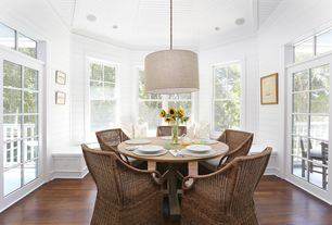 Cottage Dining Room with double-hung window, Pendant light, Farallon armchair, Fiona grande drum pendant, Crown molding