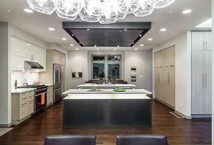 Contemporary Kitchen with Chandelier, Flush, gas range, Kitchen island, Skylight, Corian counters, Large Ceramic Tile