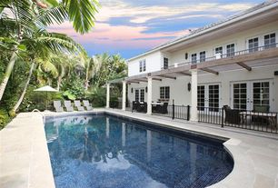 Traditional Swimming Pool with French doors, exterior stone floors, Trellis