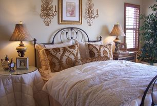 Mediterranean Master Bedroom with Wall sconce, Standard height, double-hung window