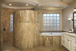 Eclectic Master Bathroom with Limestone counters, Kohler Sunward Drop-In Bath, Flush, Maxim Lighting Sconce, High ceiling