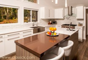 Contemporary Kitchen with Flush, electric cooktop, L-shaped, High ceiling, Bar sink, Solid surface countertop, Wall Hood