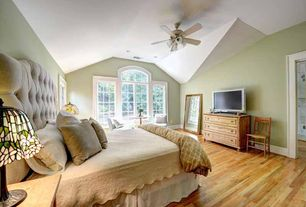 Country Master Bedroom with can lights, Ceiling fan, specialty window, Hardwood floors, Standard height