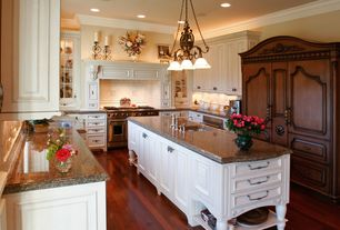 Traditional Kitchen with Crown molding, Kitchen island, Undermount sink, Glass panel, Flush, Custom hood, Stone Tile