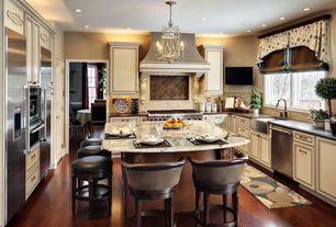 Country Kitchen with U-shaped, Pendant light, Flush, Soapstone counters, full backsplash, wall oven, Standard height