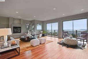 Contemporary Living Room with Laminate floors, Cement fireplace