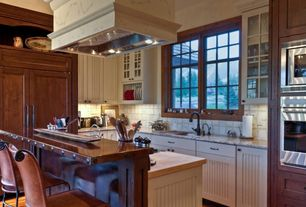 Country Kitchen with Stone Tile, Kitchen island, Flat panel cabinets, Glass panel, Undermount sink, Butcher block, L-shaped