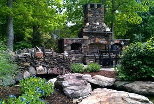 Rustic Patio with exterior stone floors, outdoor pizza oven, Pond, Pathway