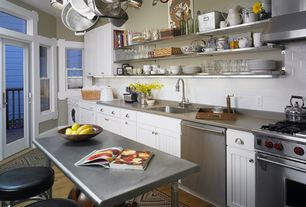 Contemporary Kitchen with European Cabinets, Subway Tile, Kitchen island, Stainless steel counters, Soapstone counters, Flush